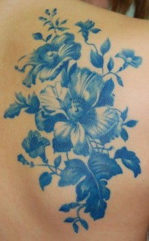 Blue ink flower tattoo