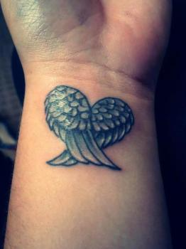 Wrist tattoo heart of wings