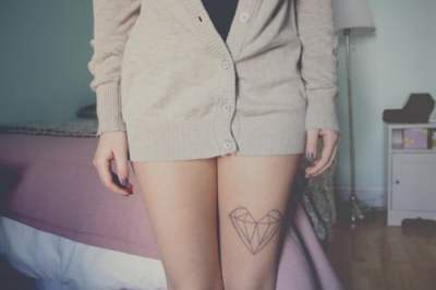 Hipster heart tattoo on leg