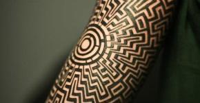 labyrinth tattoo on arm