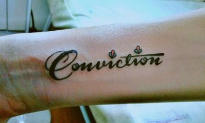 Conviction arm tattoo