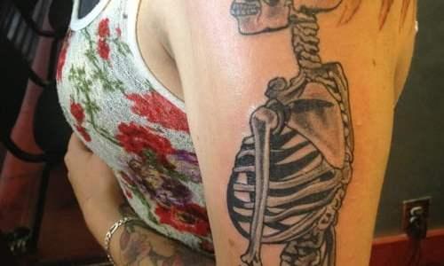 Skeleton tattoo on arm and shoulder