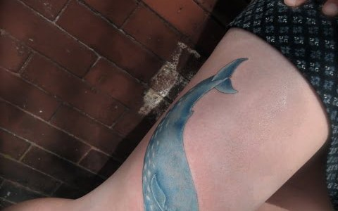 Whale tattoo on leg