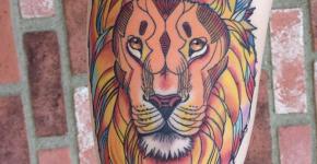 Tatuaje león en la pierna