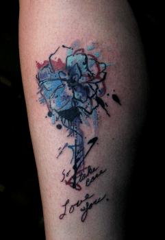 Tatuaje flor dedicada