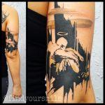 Tatuaje ángel en el brazo