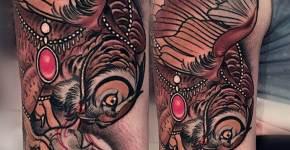 Tatuaje búho cazando