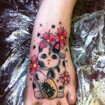 tatuaje gatito de la suerte
