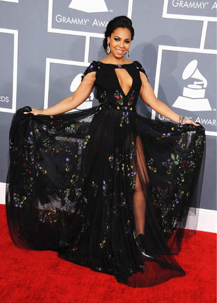 Ashanti in a black Tony Ward Couture gown with floral details