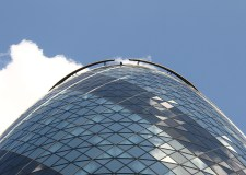 The Gherkin building, bright blue sky