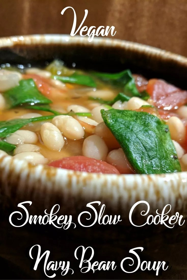 This vegan slow cooker navy bean soup maintains the traditional smokey flavor that makes Navy Bean Soup so popular! Round out the meal with some crusty bread. I don't soak my beans and this recipe always turns out great! #NationalBeanDay #NationalSoupMonth #NationalSlowCookerMonth
