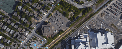 The green space across the parking lot is supposed to become a grocery store/ seniors' residence. It's accessibility will be greatly improved with the new Métro entrance...
