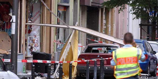 A police officer secures the traces of an explosion in the Keupstraße