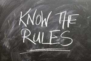 "chalkboard saying ""know the rules"" to illustrate our compliance webinar"