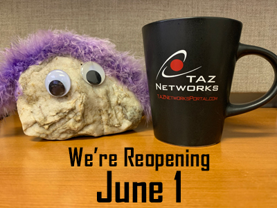 """A rock with googley eyes and purple fake fur """"hair"""" sits on a desk next to a TAZ Networks coffee mug. Text reads """"We're reopening June 1"""""""