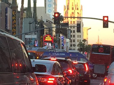 "Traffic, media and fans jammed Hollywood Blvd. in anticipation of the ""Concussion"" movie premiere."