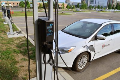 A car charges at a FLO charger within their network