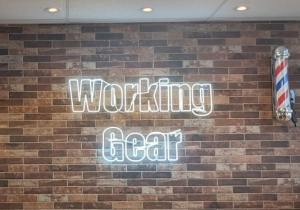 """an electric sign displaying the name """"Working Gear"""""""