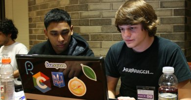 Two students working in a paired programming scenario.