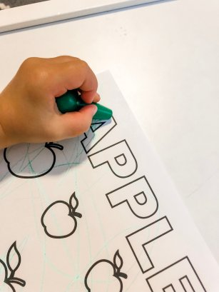A fall apple activity with FREE PRINTABLES for your toddler to develop fine motor skills using stickers, crayons, or dot markers. Help them to learn colors & counting as well during this activity.