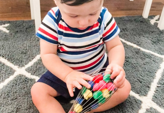 PomPom Whisk: A Baby Fine Motor Activity