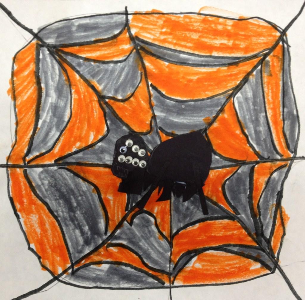 Orange and gray spiderweb with spider