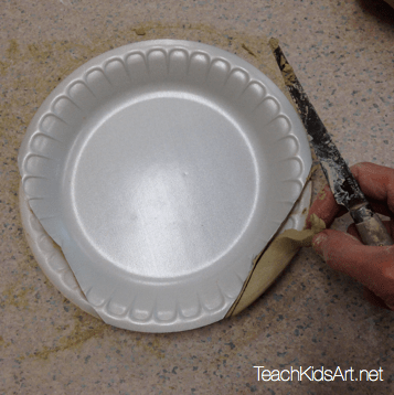 Trimming away the extra clay around the Sugar Skull template