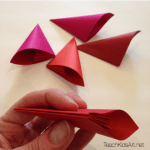 Origami Flower Balls - Step 2. Fold 5 petals, gluing each one's flat, triangular surfaces together.