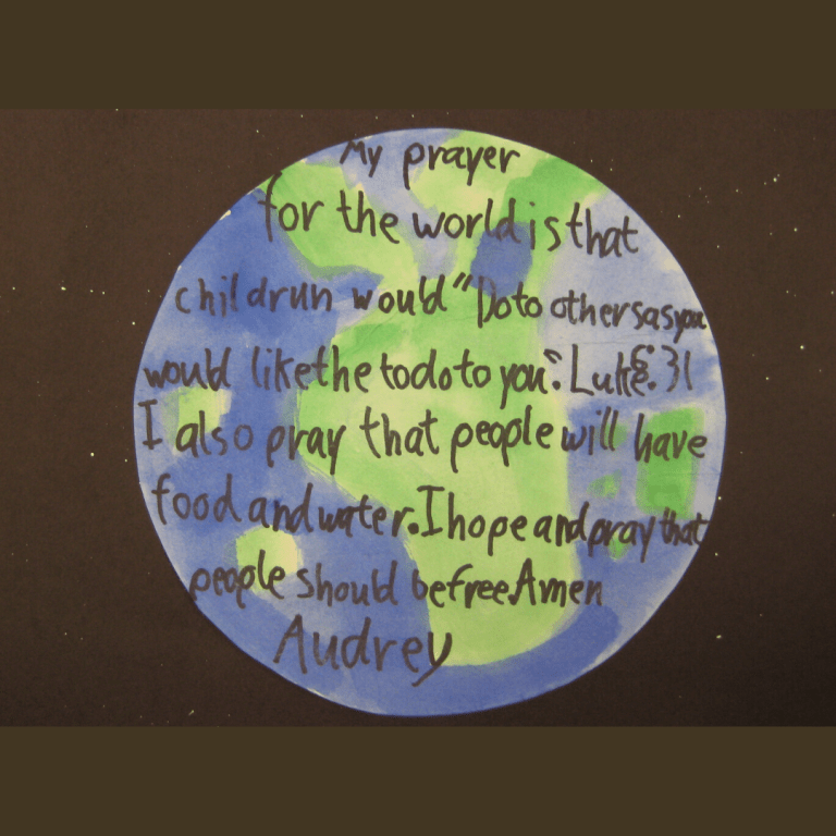 photo of a child's prayer for the world on top of their painting of the Earth as seen from space