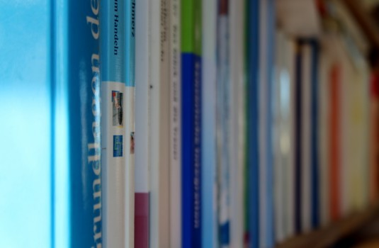 a bookshelf of textbooks