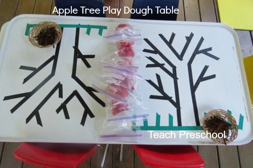 Building fine motor skills at the apple tree play dough table