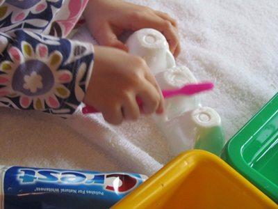 Toothbrush water play in preschool