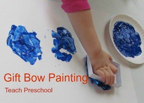 Christmas bow painting in preschool