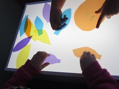 Exploring the light table in preschool