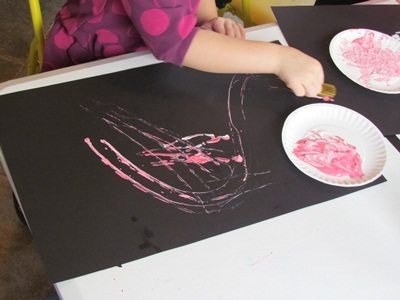 Pretty pink and blue car painting in preschool