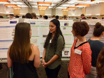 Juliana talking about her research