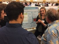 Ashley describes her project to a symposium guest