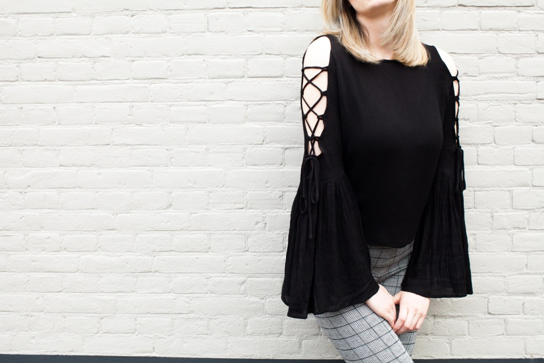 Black lace up open shoulder top with bell sleeves