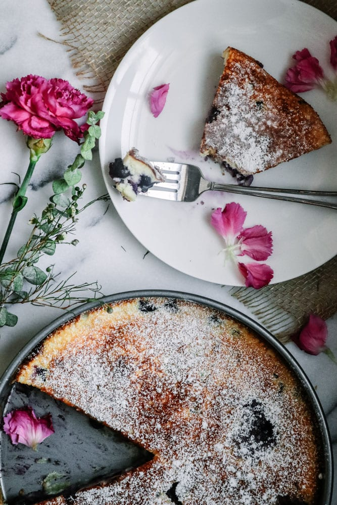 Gluten-Free Blueberry Lemon Clafoutis. Easy (it\'s prepared in a blender) & Healthy dessert fool-proof recipe that\'ll have you craving another slice. This recipe results in a smooth, not mushy, perfectly custard-like dessert that\'s perfect for any occasion. #glutenfreedesserts