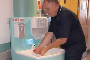 Teal portable hand wash station for hospitals at IPS meetings