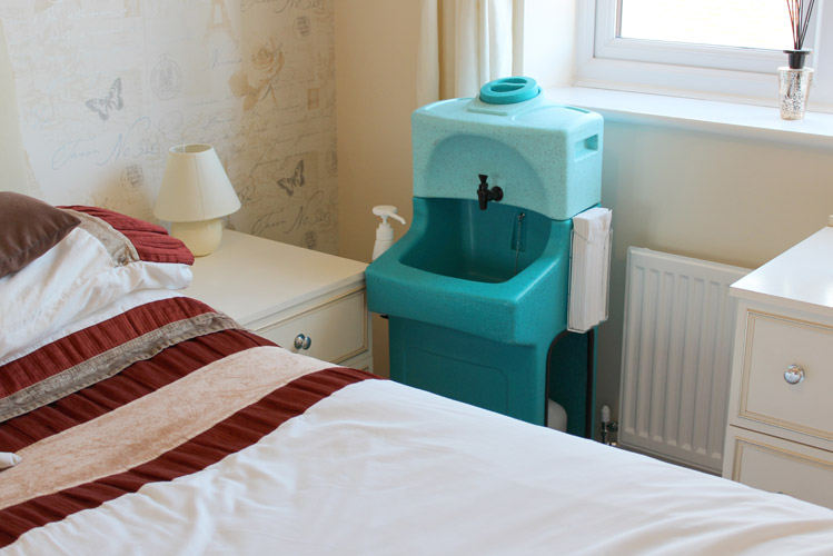 The Teal WashStand provides hand washing wherever it's needed