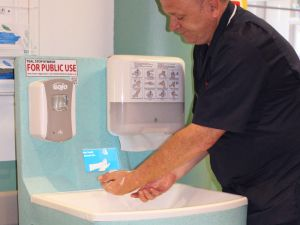 Hospital medical staff washing hands with a Teal Mediwash portable sink