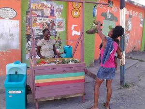 Teal WashStand and Handeman Xtra portable sinks being used by street food trader in Jamaica