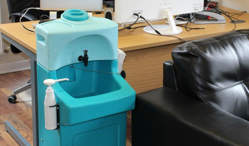 A portable hand wash unit in a care home office
