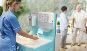 Care home staff member washing hands with a MediWash portable sink