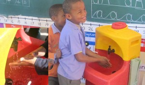 Children washing hands in the classroom with a KiddiSynk
