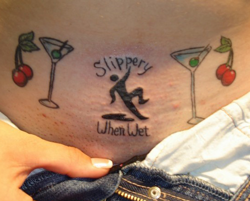 Slippery When Wet Stomach Pubic Tattoo, Bad Tattos, Worst Tattoos Funny Tattoos Studpid tattoos, body art tramp stamps horrible tattoos best tattoos awesome tattoos body piercings crazy tattos on arm face tats tatto removal worst ever