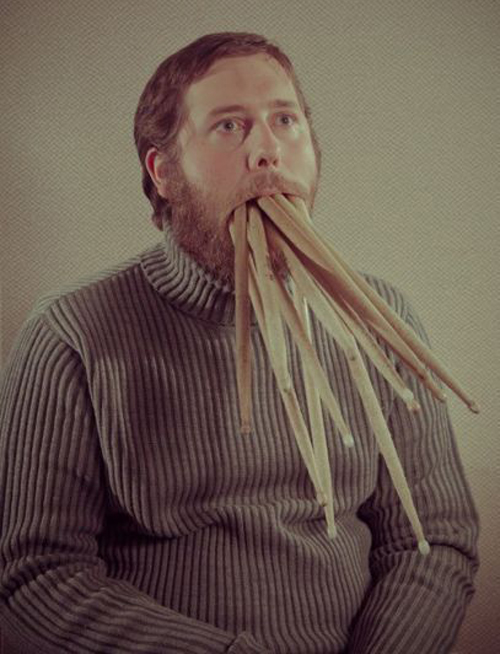 Man with Drum Sticks in his mouth, Worst Family Photos Bad Family Portraits, Bad Family Photos, Ellen, funny family photos, worst family pics, funny pictures, awkward family photos, wtf, ugly people, stupid people, crazy people, people of walmart