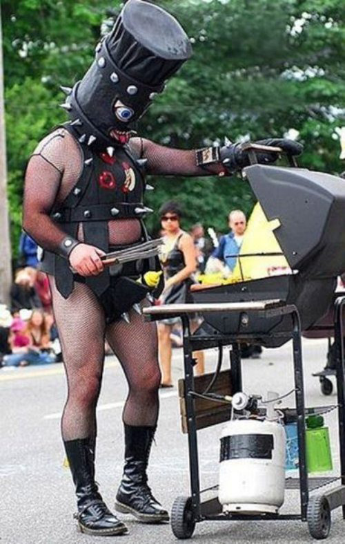 Grilling in S & M B & D Leather outfit Bad Family Portraits, Bad Family Photos, Ellen, funny family photos, worst family pics, funny pictures, awkward family photos, wtf, ugly people, stupid people, crazy people, people of walmart