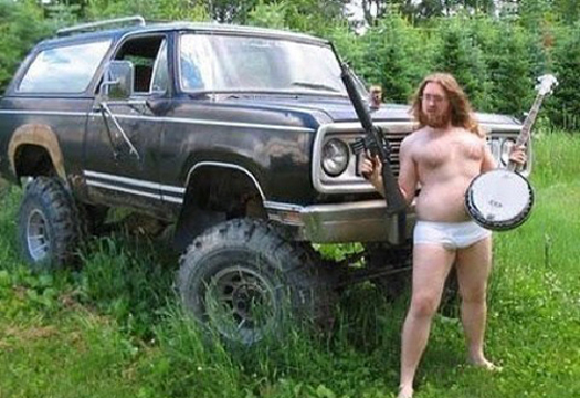 Redneck with Gun Bango in front of truck Bad Family Portraits, Bad Family Photos, Ellen, funny family photos, worst family pics, funny pictures, awkward family photos, wtf, ugly people, stupid people, crazy people, people of walmart
